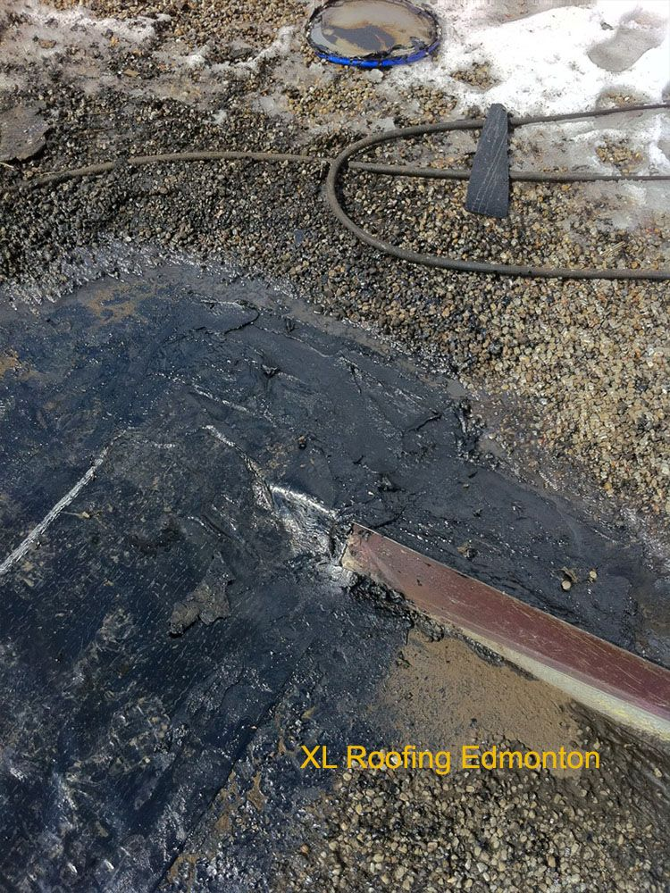 This Home Owner Has A Low Slope Tar And Gravel Roof The