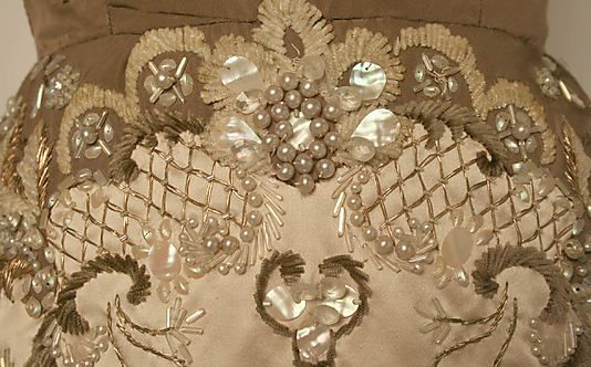 """Embroidery detail of """"Oriane"""" by the House of Balmain, fall/winter 1954-1955. Pearls, shells, gold thread, chenille, etc."""