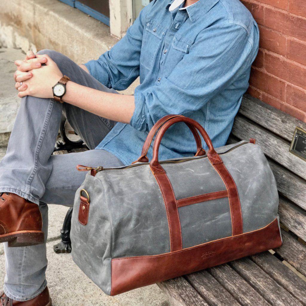 b9add8074ed171 vintage brown leather waxed canvas weekender duffel brick background ...