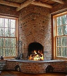 rounded opening of corner fireplace w/ curved hearth/flowing