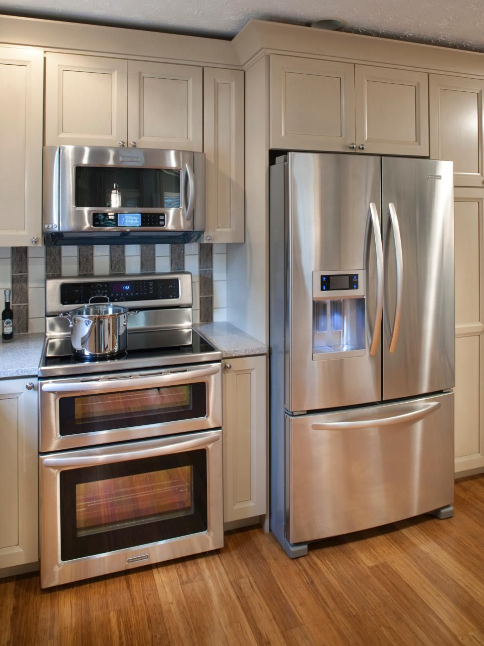 Neutral Kitchen Cabinets Provide Convenient Storage And A Clean Facade In This Stainless Steel