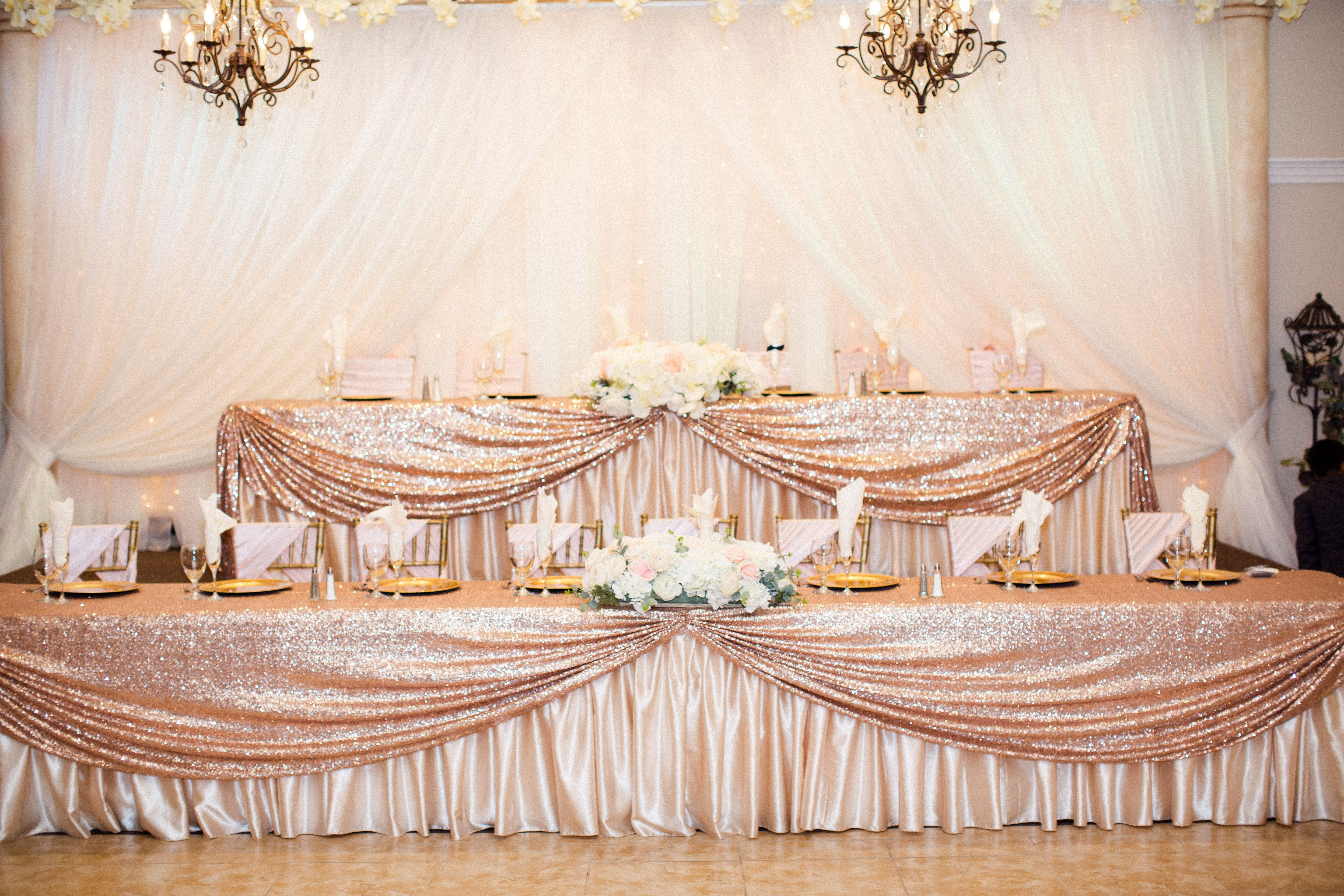 Head Table Decorated With Champagne Skirt And Rose Gold Sequin