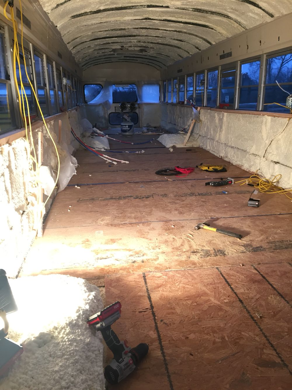 Subfloor installed over the floor framing and insulation School Bus ...