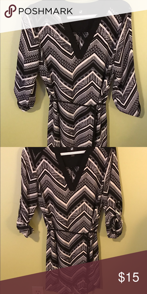 Tunic style shirt V necked dressy tunic style shirt.  Great to wear with leggings and boots! 3/4 length sleeves with a fabric belt. Iz Byer Tops Tunics