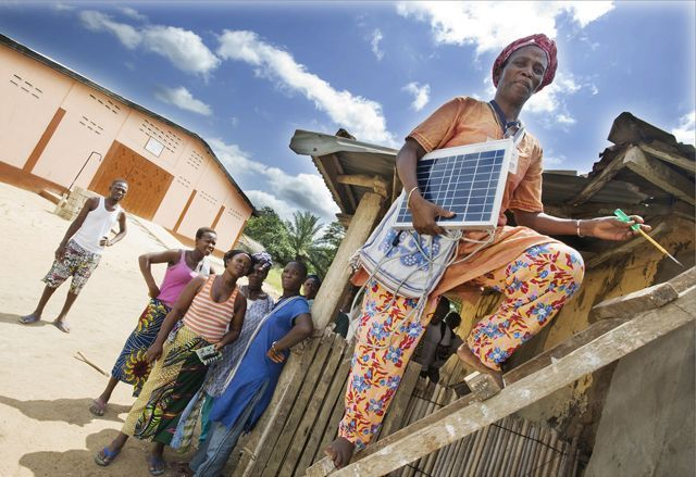 Mialo Tassi A Solar Grandmother Erecting A Solar Panel On A Small Home In Agame Sevah Village Togo Photo Lar Boland