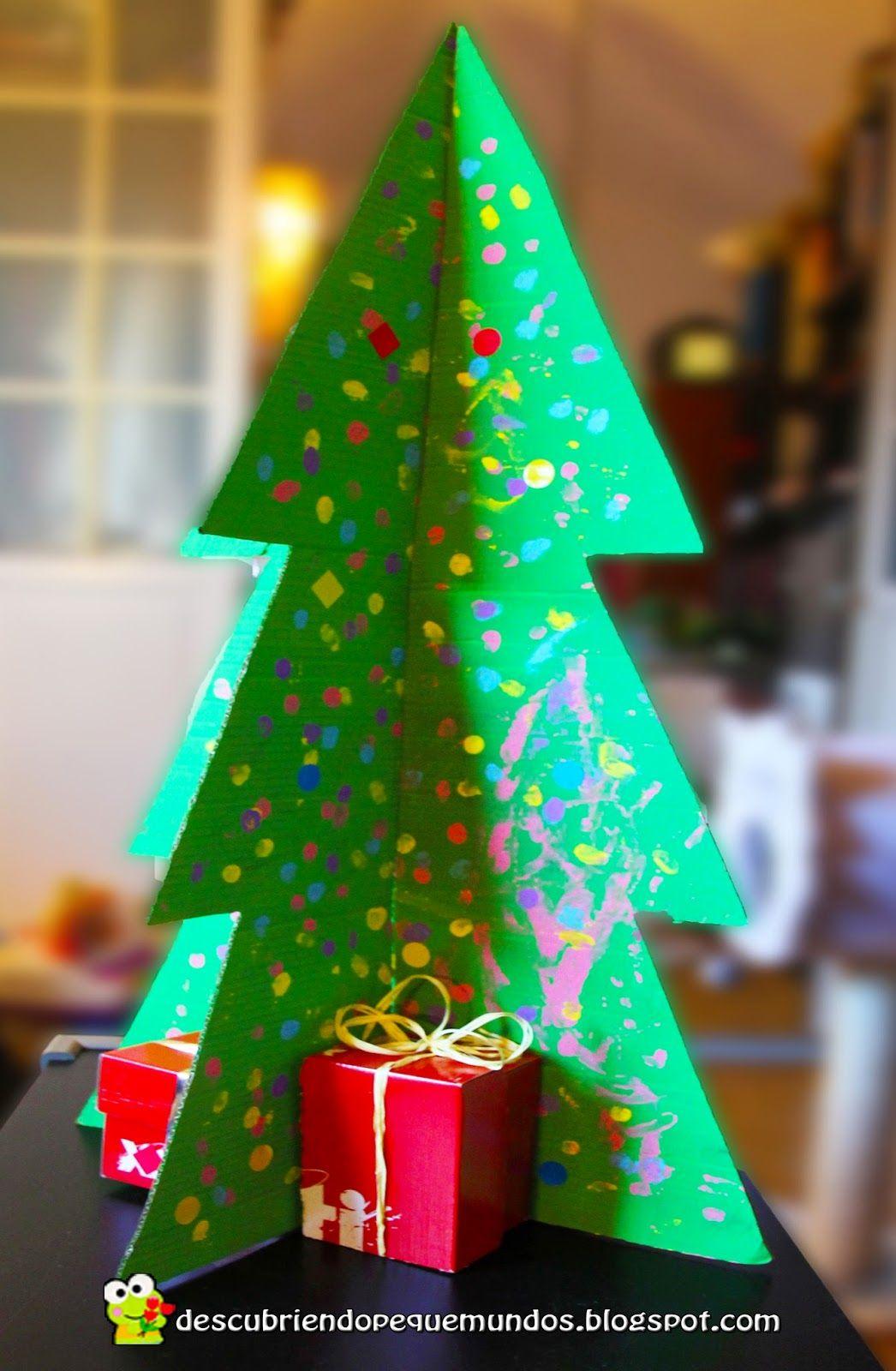 Rbol de navidad 3d con materiales reciclados for Manualidades de navidad para ninos