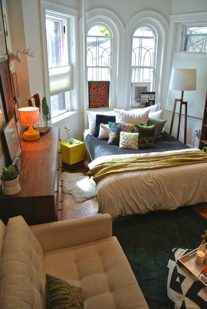 Use rugs and light to define rooms in open floor plans and studio apartments.