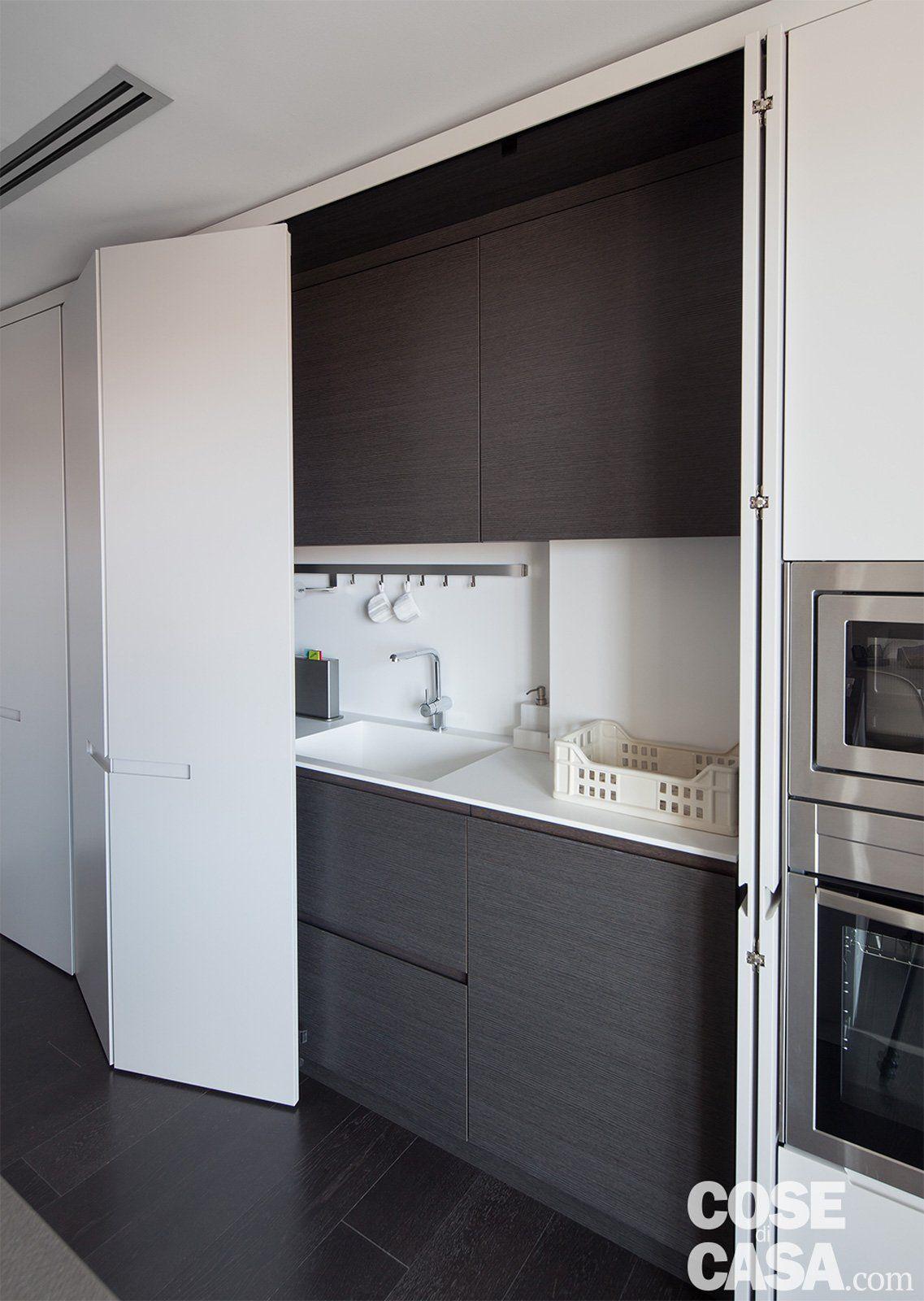 Mobiletto Per Appoggiare Microonde 75 mq: una casa con geometrie in bianco e nero   case