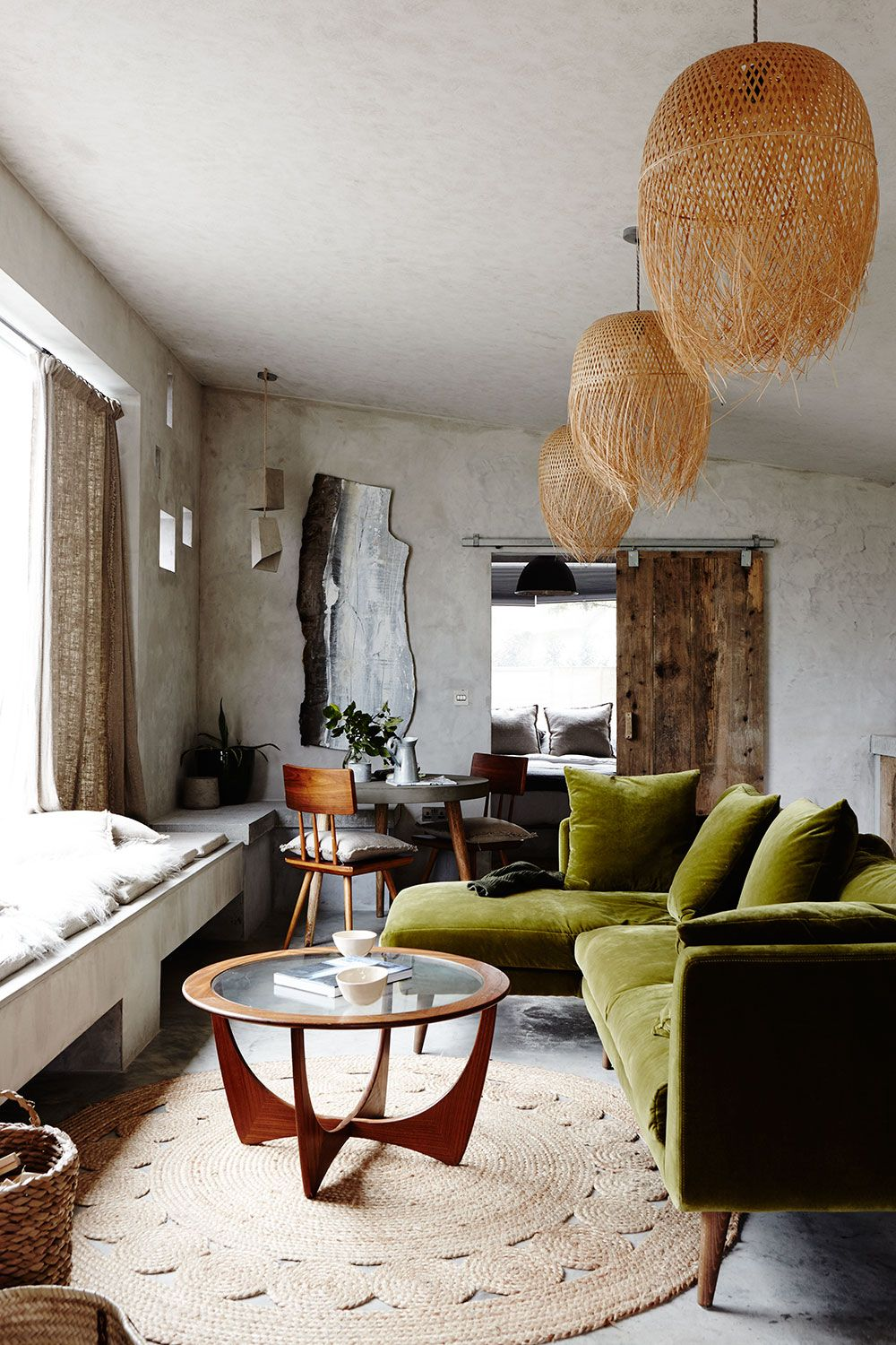 Rustic eclectic open plan living with olive green velvet ...