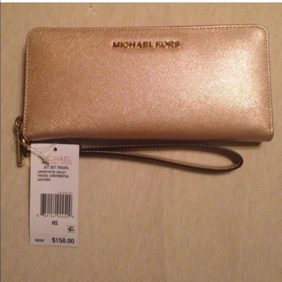 dd9accc7538d9 Michael Kors Rose Gold Wallet Wristlet NWOT. 100% Authentic!! Must have!  Worn Once! Price Firm! No Trades! Michael Kors Bags Clutches & Wristlets