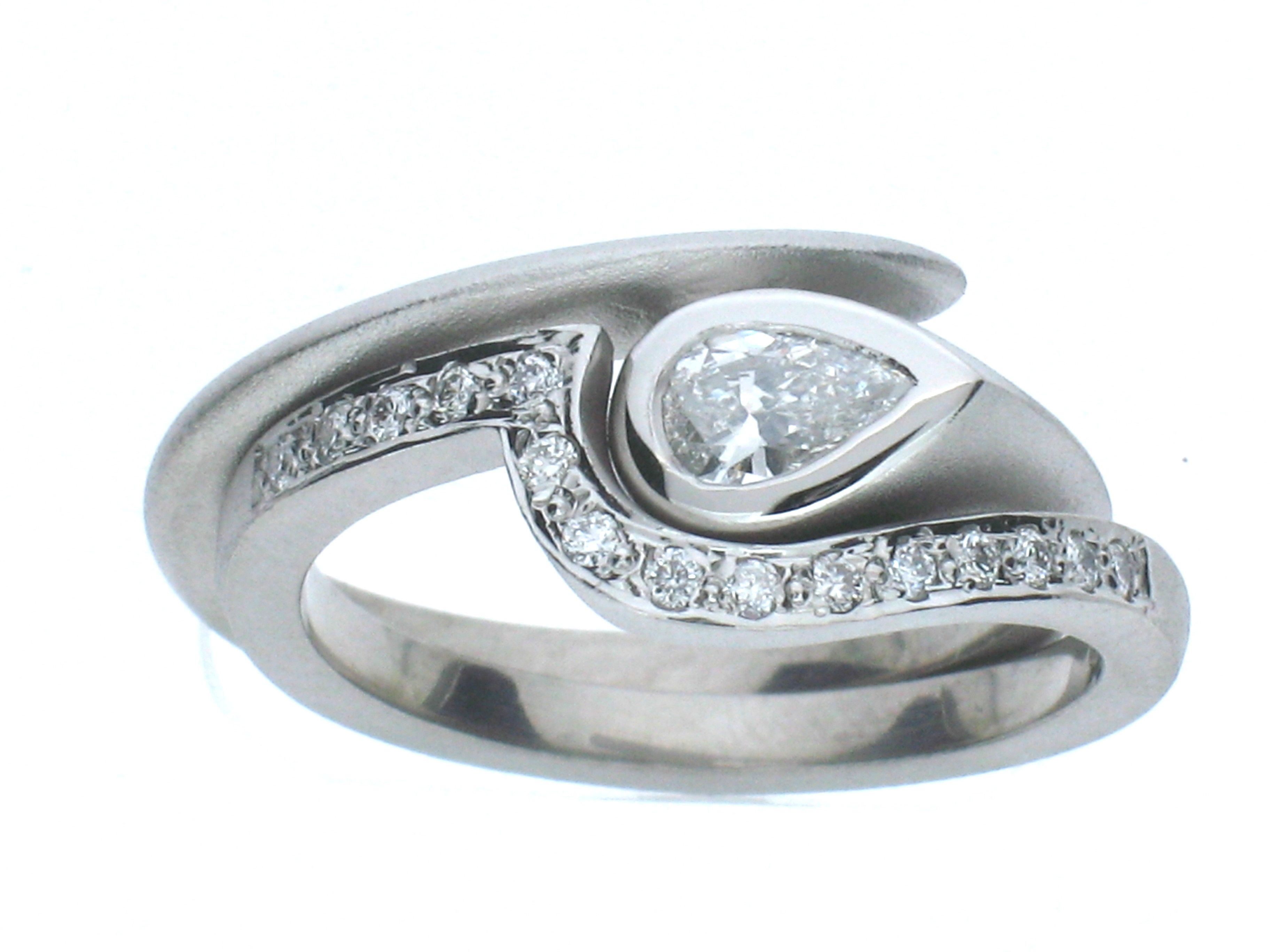 Bridal set in frosted palladium brilliant pear diamond shaped band