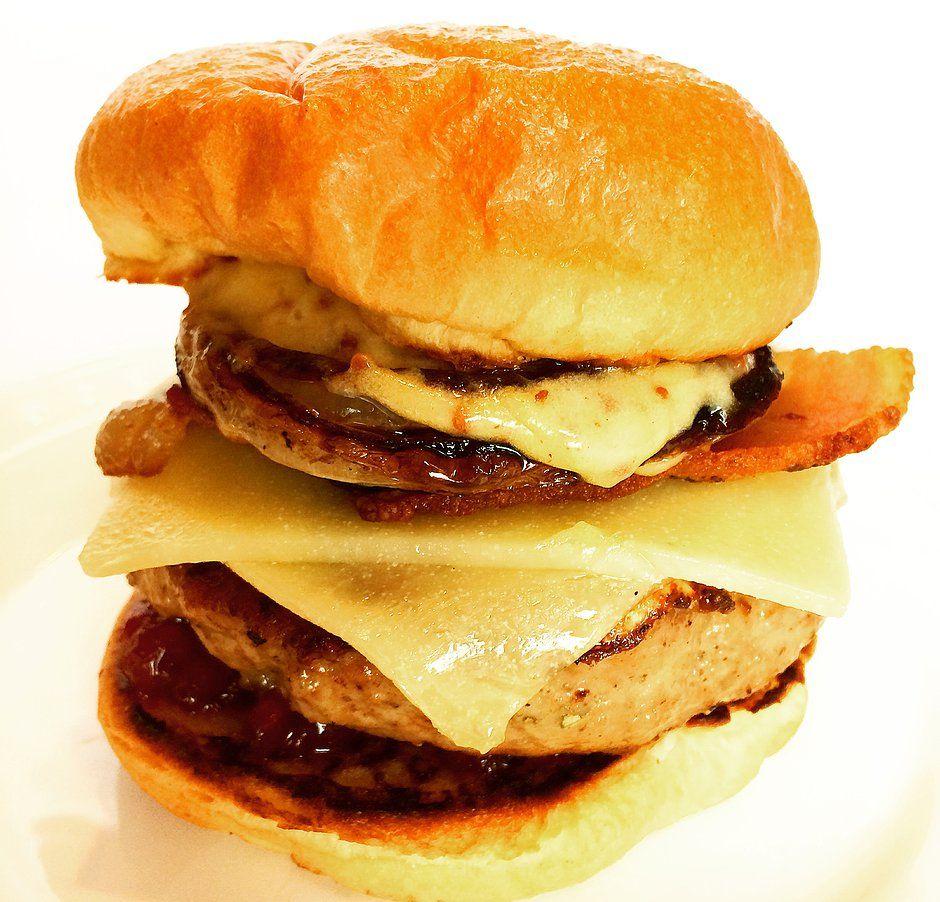Breakfast Sausage Sandwich! Pork breakfast sausage, fried egg, honey mustard aioli, lingonberry, white cheddar, onion steak on brioche.