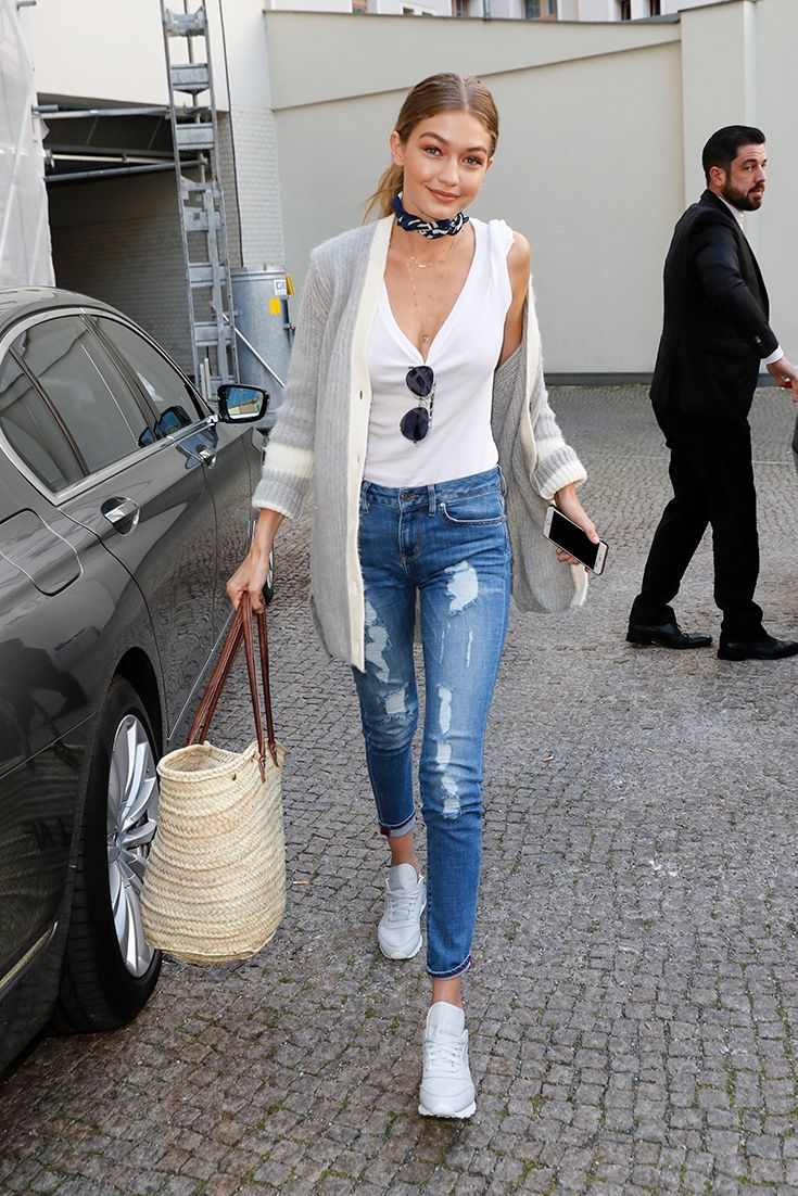2dbfed21f4b Gigi Hadid looking bodacious in distressed jeans and a simple white tank  vest
