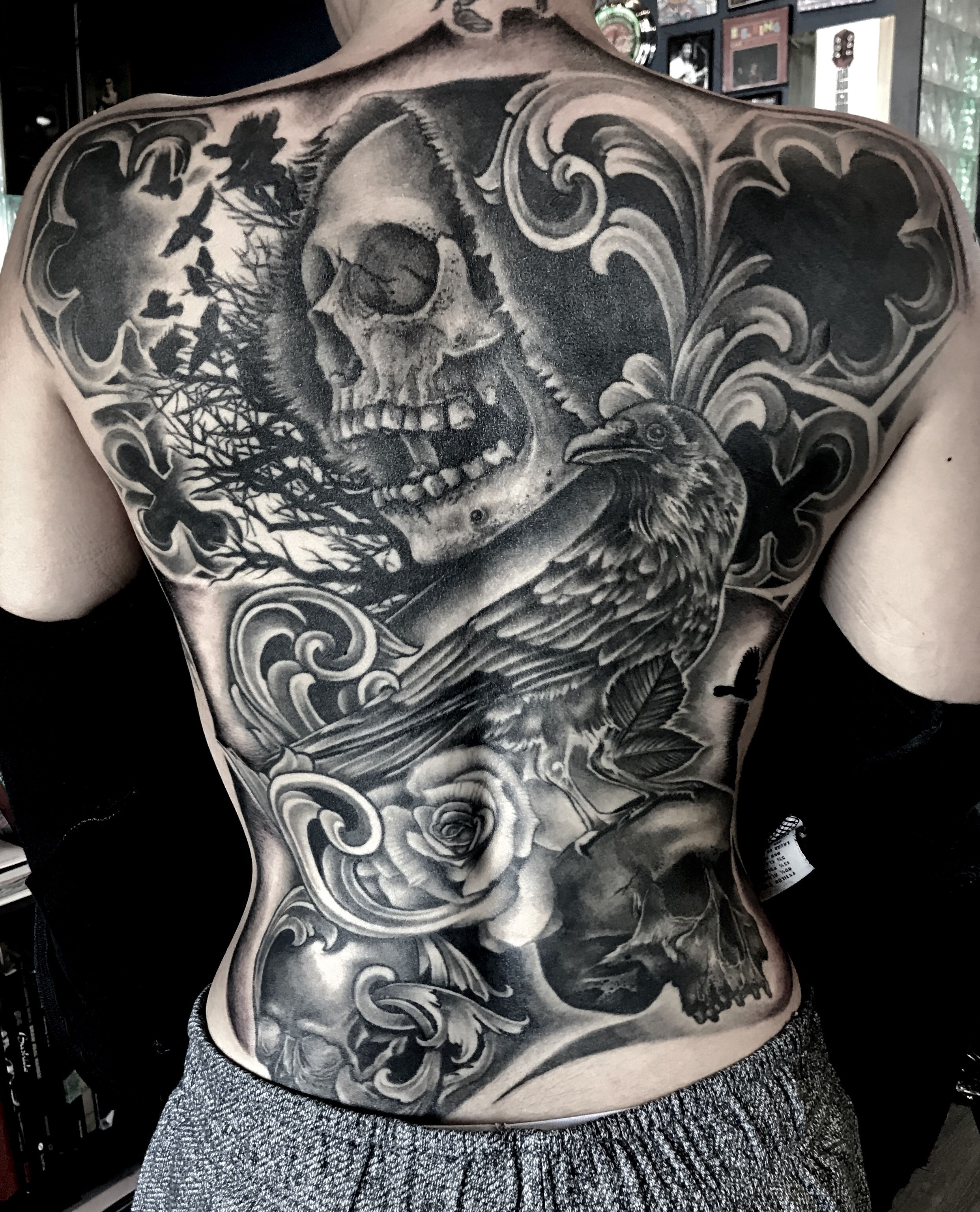 Full Back piece by Krystof at Bluenote Tattoo, skulls