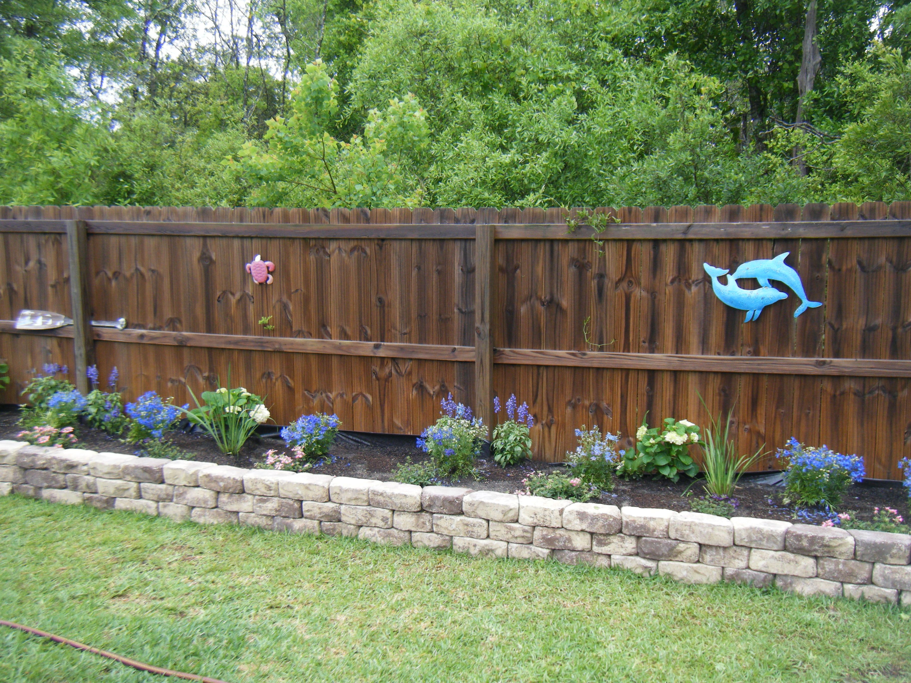 Raised Flower Bed…this would look so much better than our