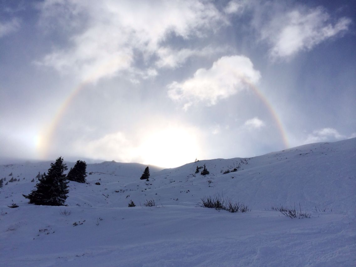 Rainbow as seen from the freeride from Alp Dado to Plaun