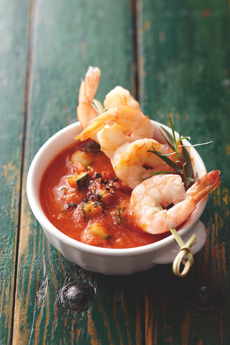 Upgrade your gazpacho by using roasted tomatoes and adding a shrimp skewer on top.