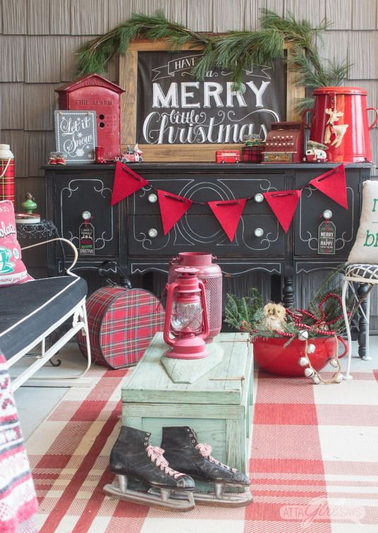 These vintage black red and green Christmas front porch decorations are so pretty Santa and Mrs. Claus had to check them out! Tour this gorgeous Christmas porch and 17 other festive porches decked out for the holiday.