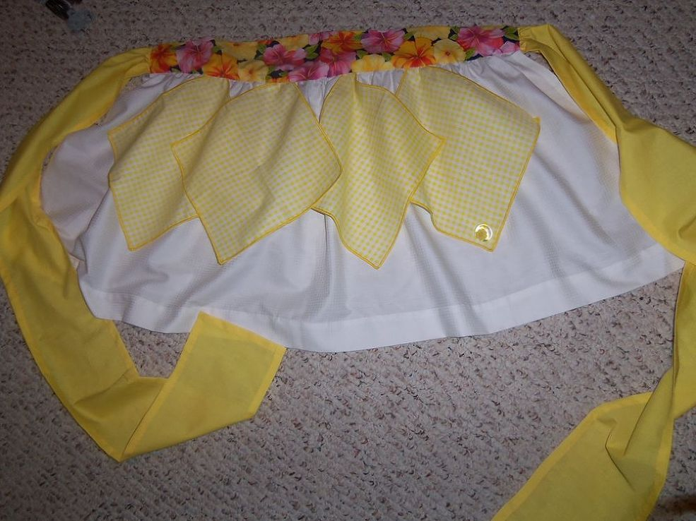 Hankies over polished cotton skirt. Features floral waistband and good luck charm detail. Hand-sewn.