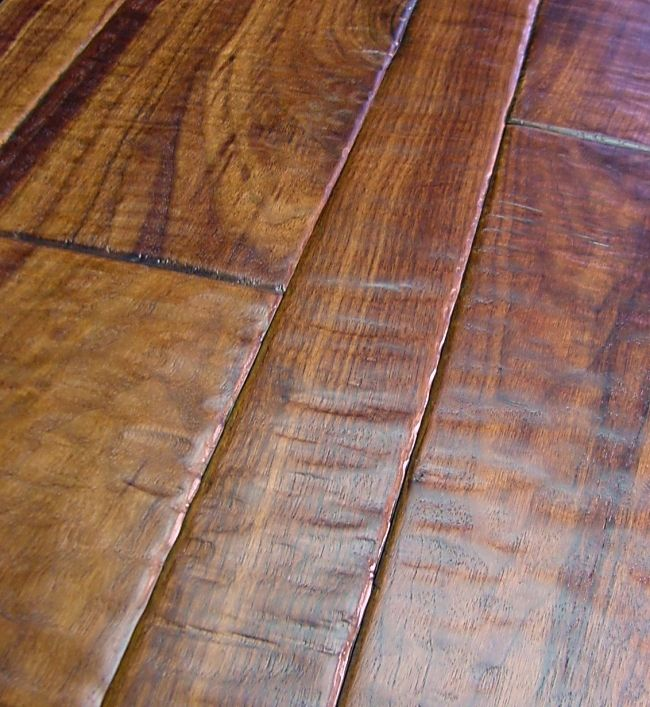 This is actually a hand scraped Walnut wood floor by Pennington