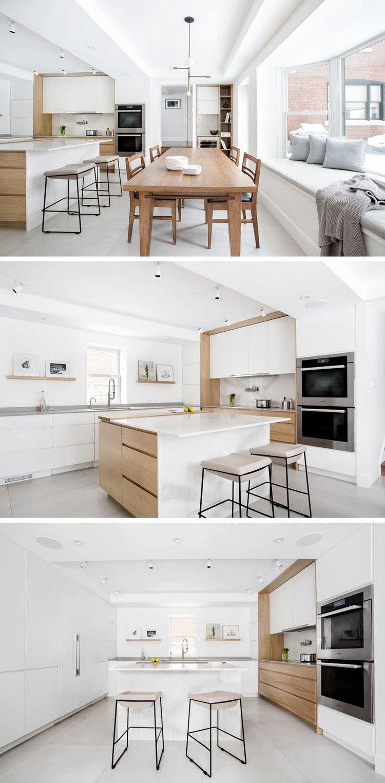 Küche mit Essbereich und Kücheninsel nach einer Renovierung ...
