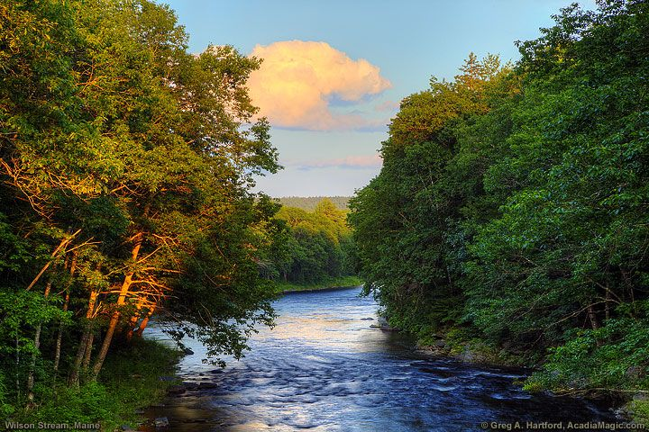 The bridge in Willimantic, Maine provides a great view of Wilson Stream as in this image as the sun was setting in the west.
