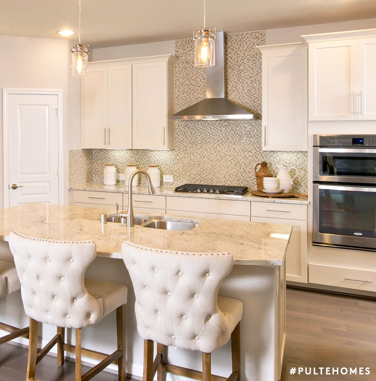 Natural Wood Accents Paired With Full Wall Backsplash