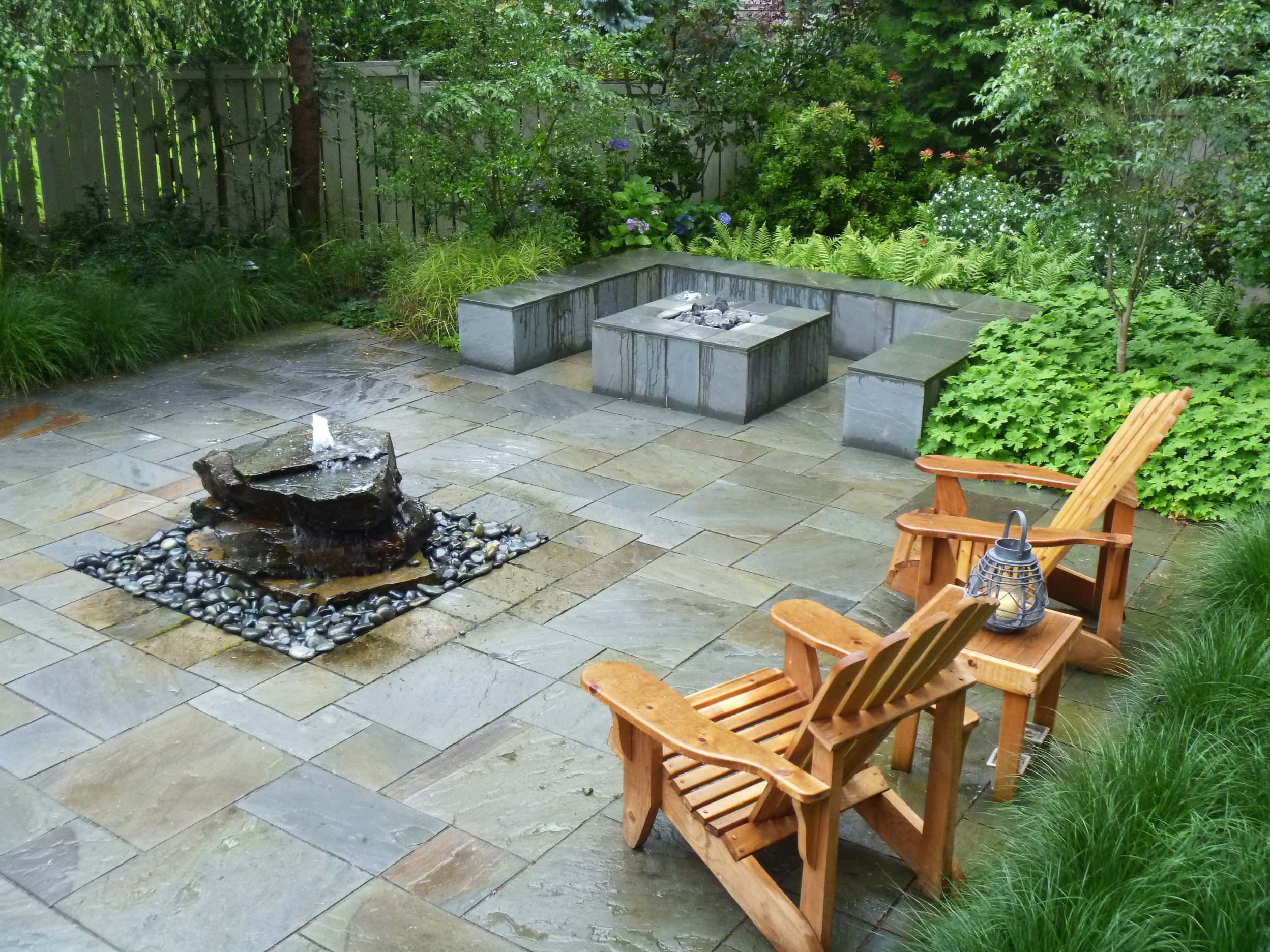 Contemporary House: Stone Pavers And Pondless Water Features With Gravels  Also Patio Furniture And Outdoor