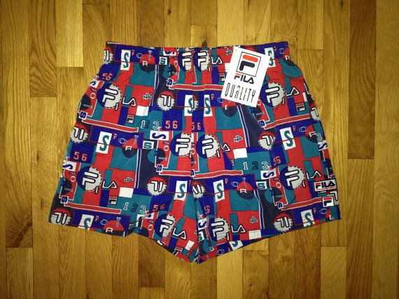 90s FILA shorts.  deadstock.  NWT.  red, teal, royal blue, navy blue & white.  sewn logo on front left.  drawstring waist.  side pockets.