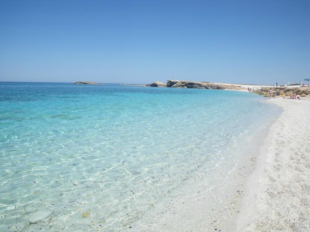 Playa  en la provincia de Oristano -  Is Aruttas, Cabras - Arena cuarzo blanco como granitos de arroz