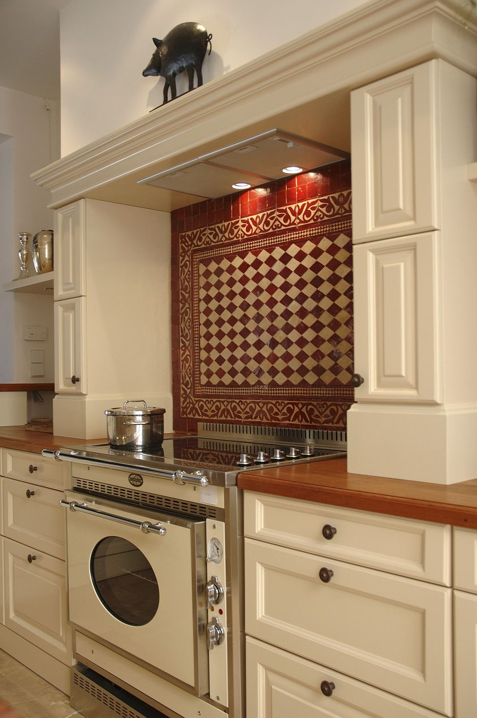 Country Kitchen With Cream Cabinets And Red Tile Backsplash Lonny
