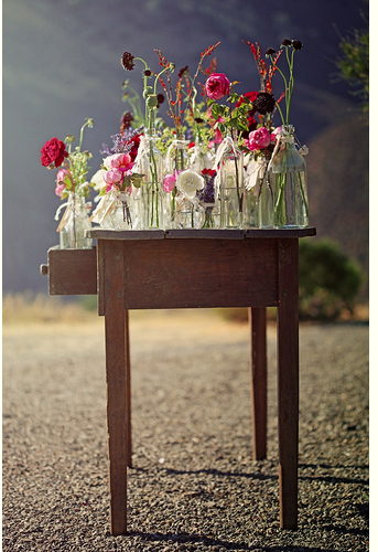 glass bottles and wild flowers