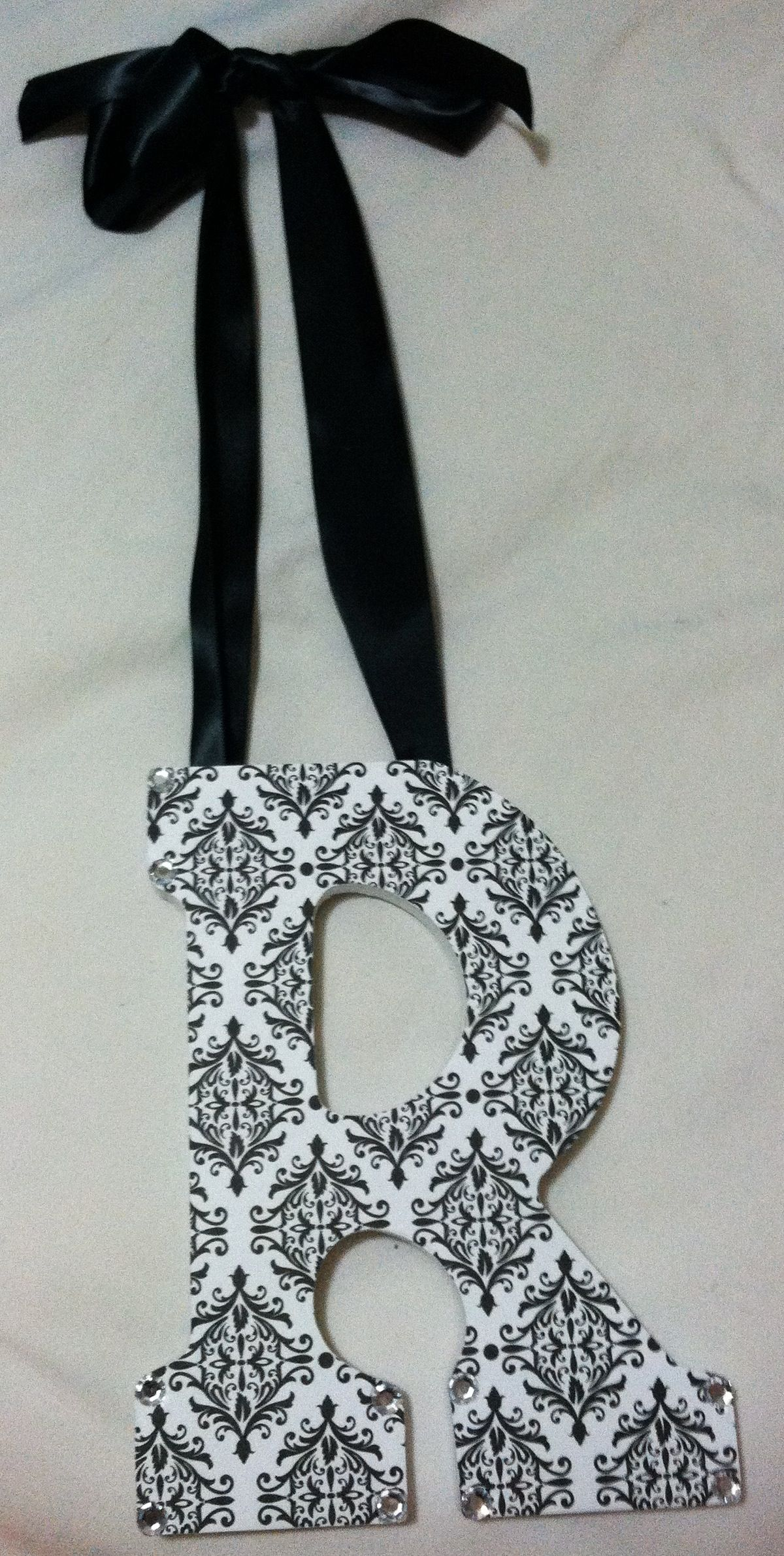 """Custom wooden """"R"""" initial in black and white damask pattern with black satin ribbon and rhinestones for a customer in Illinois!-SOLD  www.Etsy.com/shop/AshleighsAffordables or check the shop out on FACEBOOK!!!"""