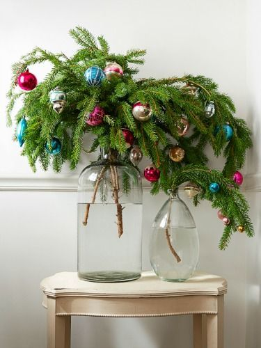 Evergreen Branches With Ornaments In Oversize Jars And Vases A Good Alternative To Mini Small Christmas Trees Alternative Christmas Tree Christmas Decorations