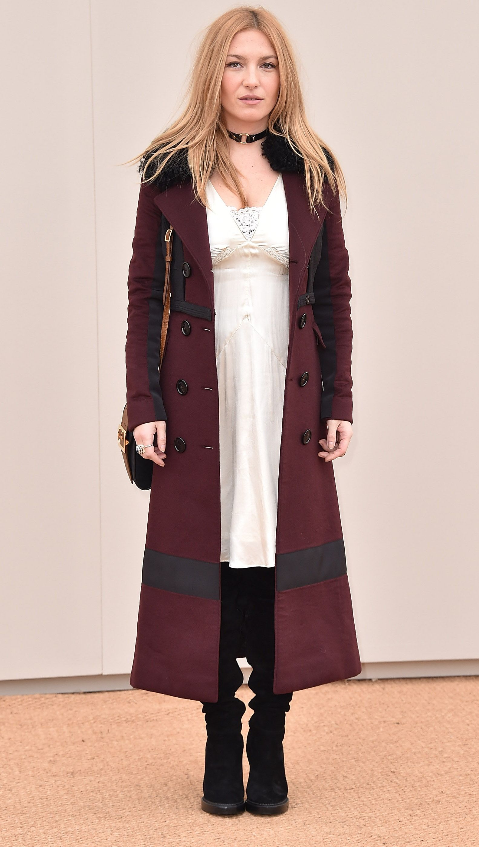 d05c3bec928 Josephine De La Baume wearing a Burberry trench coat to arrive at the  Burberry 2016 Menswear show