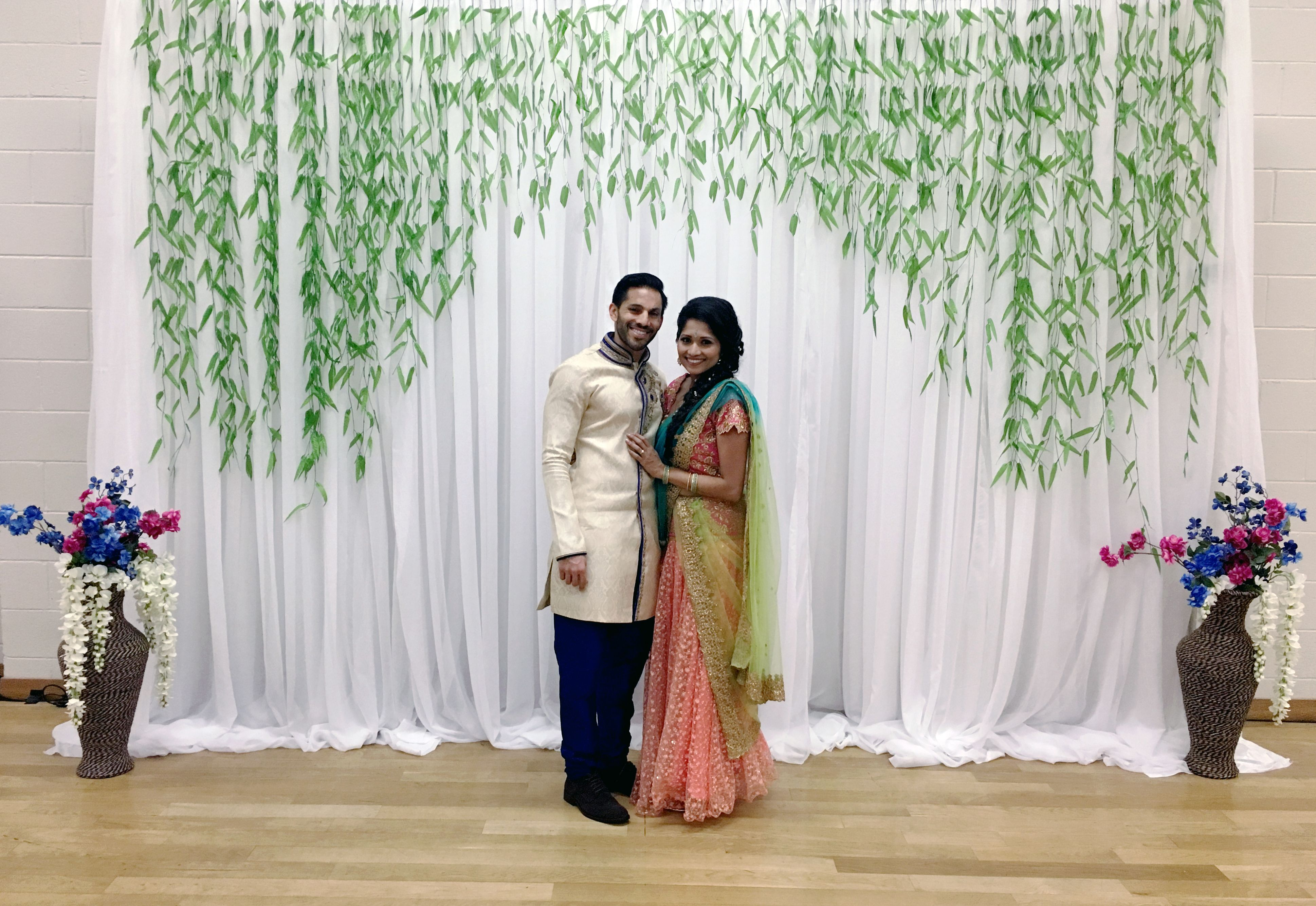 Green Rain Backdrop White Sheer Backdrop With Greenery For This Indian Engagement Party Engagement Party Backdrop Wedding Draping Green Backdrops