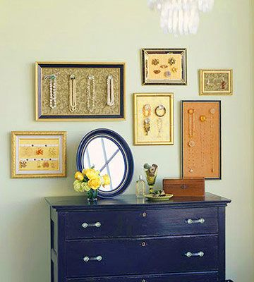 Don't hide your jewelry, display it.  Back picture frames with paper covered fiberboard - use old cabinet knobs and pushpins to hand necklaces n bracelets.  Secure ribbon with thumbtacks and dangle earrings.  Even use corkboard!  NICE!