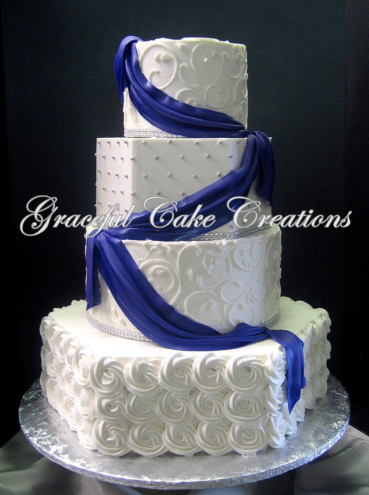 Elegant White Butter Cream Wedding Cake with Pipped Butter Cream ...