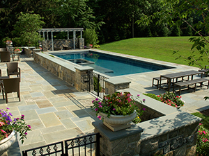 Can I Build A Pool In My Sloping Backyard Pool Contractor Services Toronto Gta Aveco Pools Backyard Pool Pool Landscaping Sloped Backyard