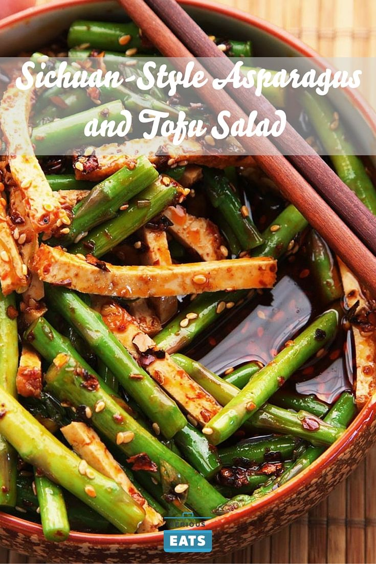 A very quick and easy side dish for a Chinese feast. Tender-crisp asparagus and firm tofu are tossed in a fiery-sweet Sichuan-style vinaigrette made with roasted chilies and Sichuan peppercorns.