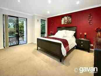 Cream Carpet With Red Feature Wall