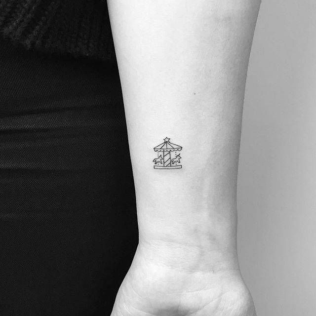 Photo of Carousel tattoo on the wrist.