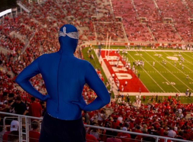A BYU super fan looks down on Utah's Rice-Eccles Stadium during the rivalry game Sept. 15, 2012. (Trent Nelson  |  The Salt Lake Tribune)
