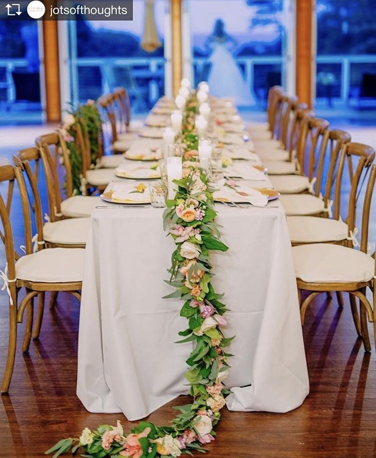 Vineyard cross back chairs with ivory pads , 8ft tables, and white linens. Repost from Jots of Thoughts and our sweet bride taking in the beautiful views of the east side  @bikinibirdie @graceflowershawaii @bigislandtents @cafepestohilo @jotsofthoughts #hawaiiwedding #hawaiiweddingplanner #hawaiilove #love #aloha #ido #initimatewedding #tablescape #garland #bride #centerpieces #roses #destinationplanner #destinationwedding #hawaiiwedding #bigislandwedding #bigislandweddingplanner
