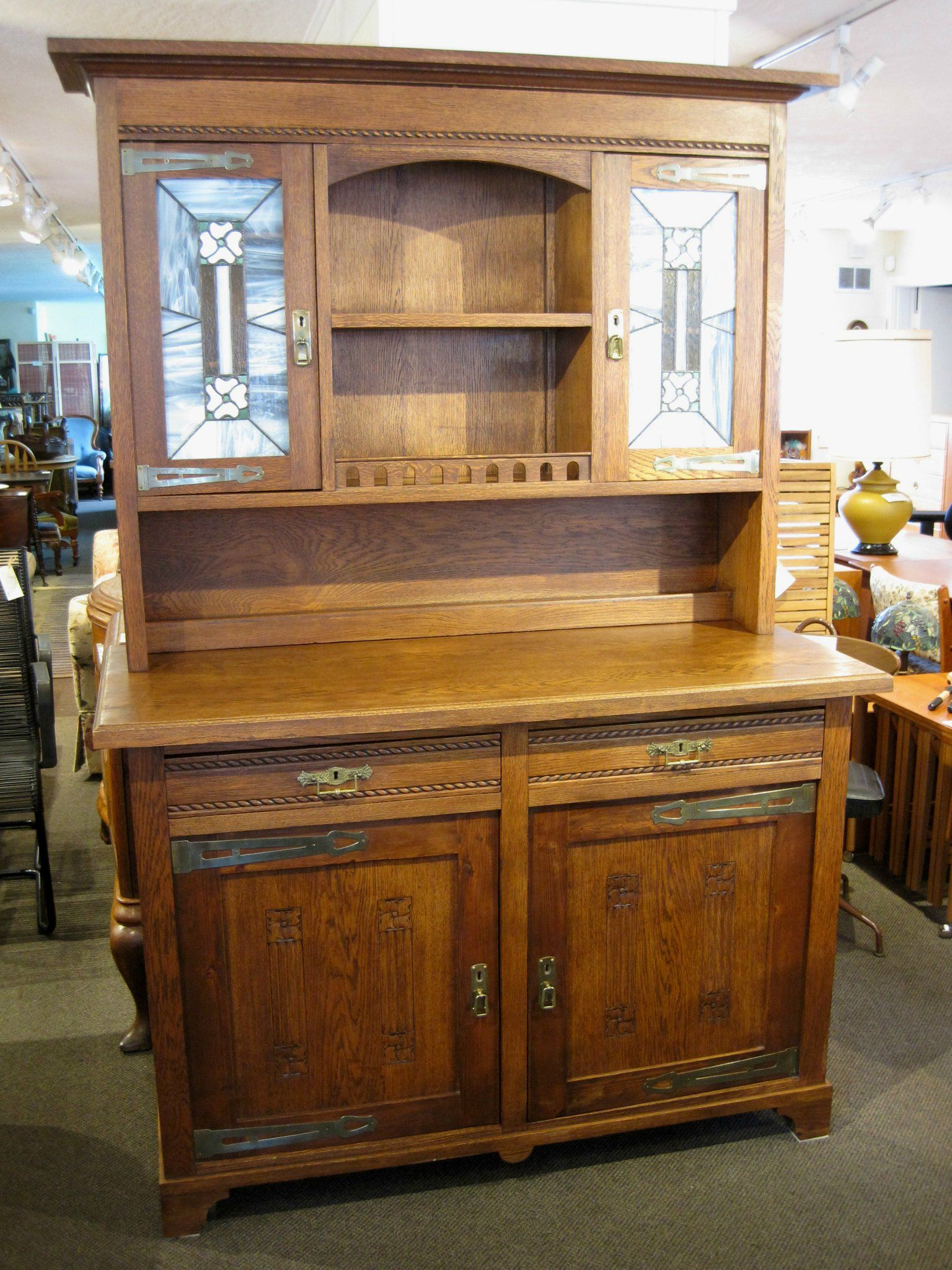 A handsome antique Arts & Crafts sideboard with stained glass doors