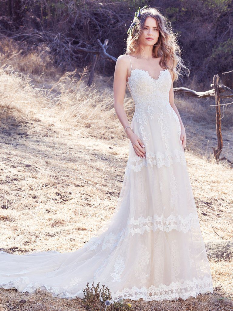 3aed06f741 Maggie Sottero - EMILY, A chic A-line with unique details, this boho  wedding dress features horizontal lace motifs, scattered lace appliqués,  and a striking ...