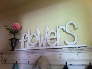 Flower sign cut out of pine board, painted and destressed
