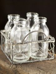 This wire caddy carries lots of charm! Rustic and sturdy, this chicken wire caddy comes complete with four small glass bottles. Functiona...
