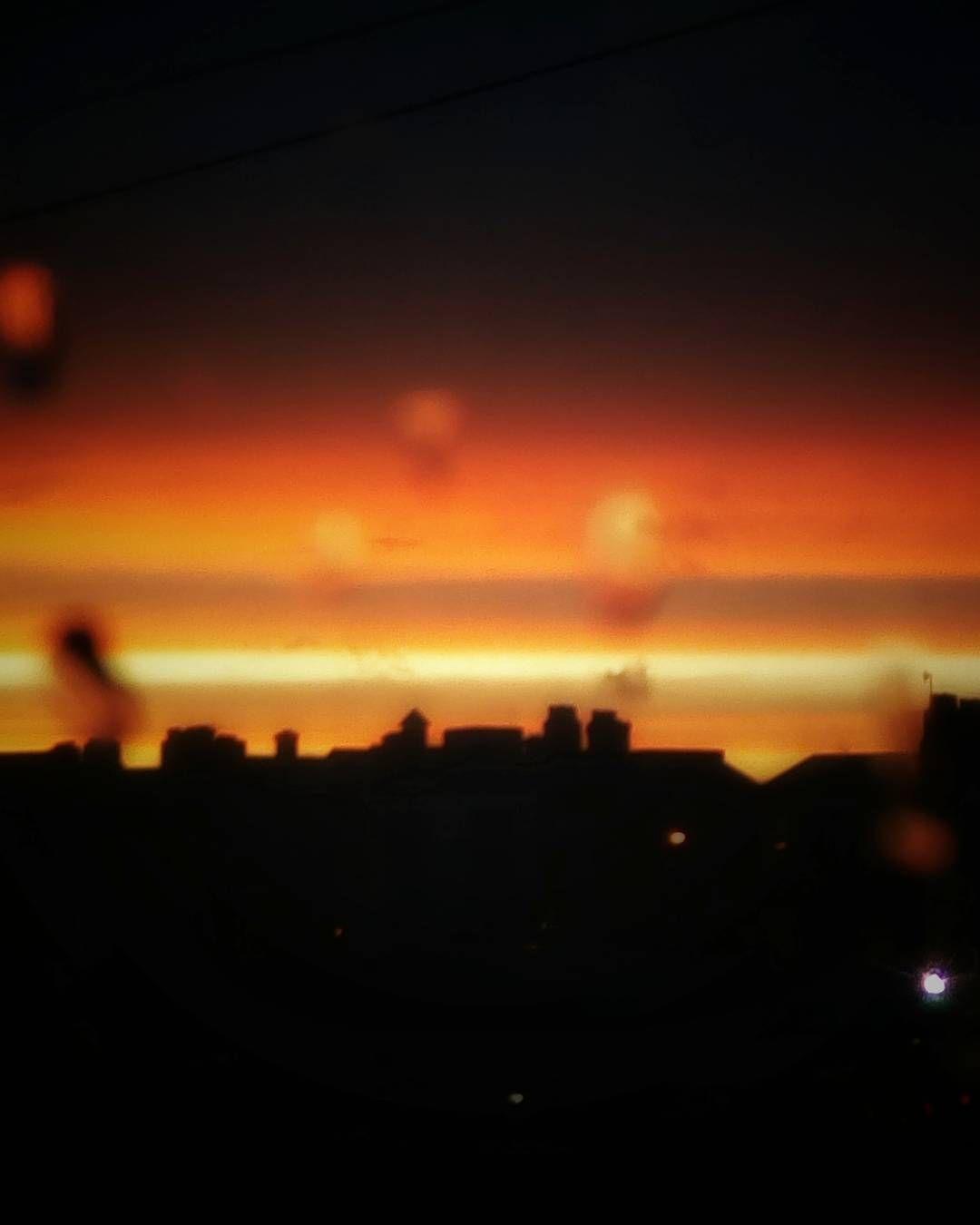 Envelope #sunset #dublin #connellystation #winter #evening #coucherdesoleil #fire #fiery #sky #skyline #clouds #rain #drops #train #weekend