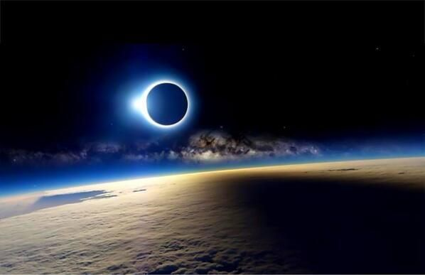 Solar Eclipse and the Milky Way over the Earth (taken from the ISS)
